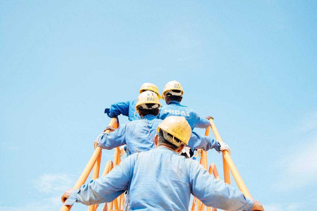 workmen climbing staircase